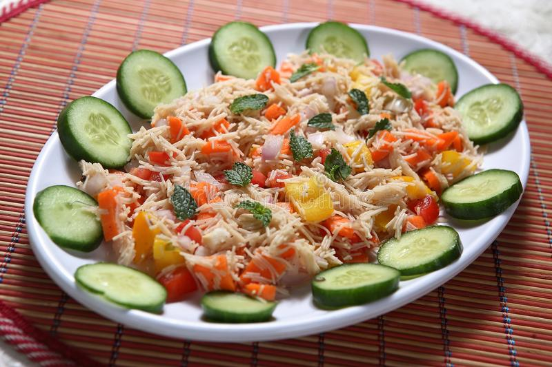 Ragi seviyan Veg Salad, Finger millet Vermicelli Veg Salad, Ragi Semiya Veg Salad. Nutritionally, ragi is used as a whole grain it is an excellent plant source royalty free stock photography
