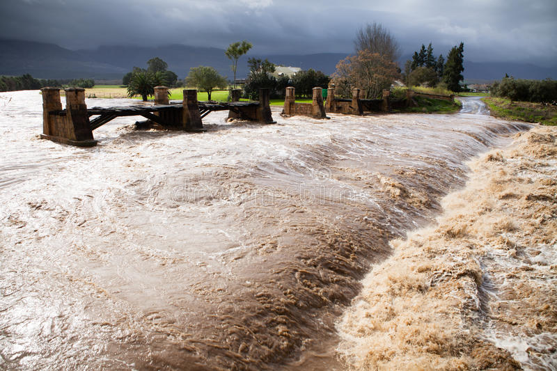 Raging flood waters of a river in flood royalty free stock photos