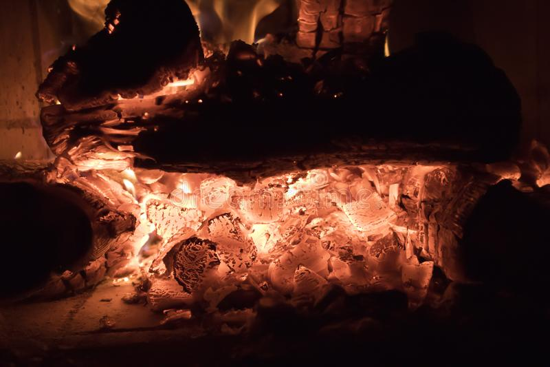 Raging forks of flame in fireplace. Behind the protective glass screen royalty free stock photos