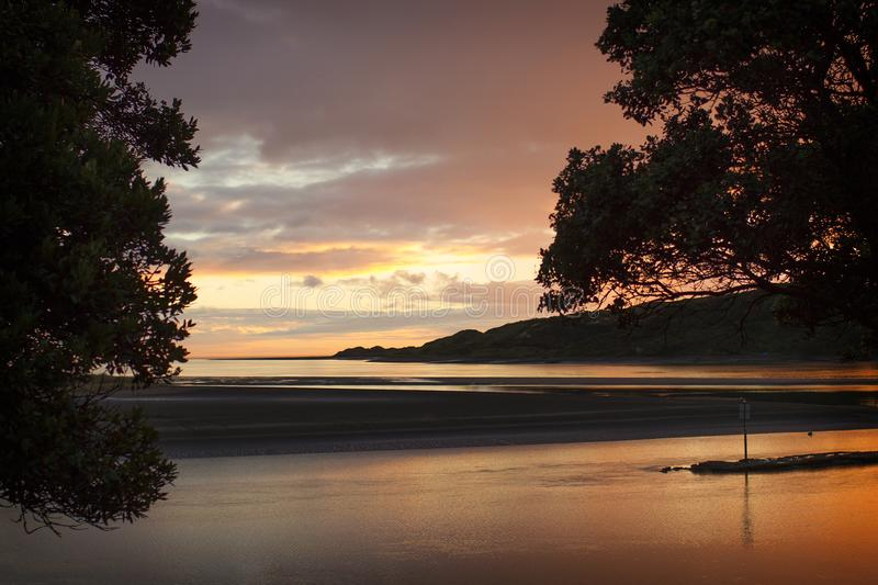 Raglan Harbour at sunset. Beautiful Raglan Harbour at dusk. Raglan on the West Coast of New Zealand is famous for its sunsets stock photos
