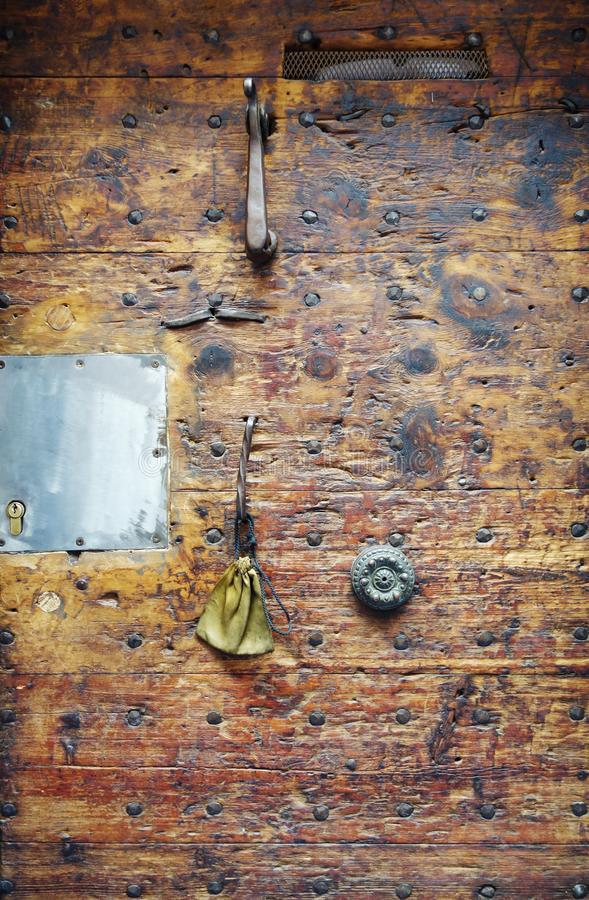 Ragment of an old Italian door with a beautiful wooden texture royalty free stock photo