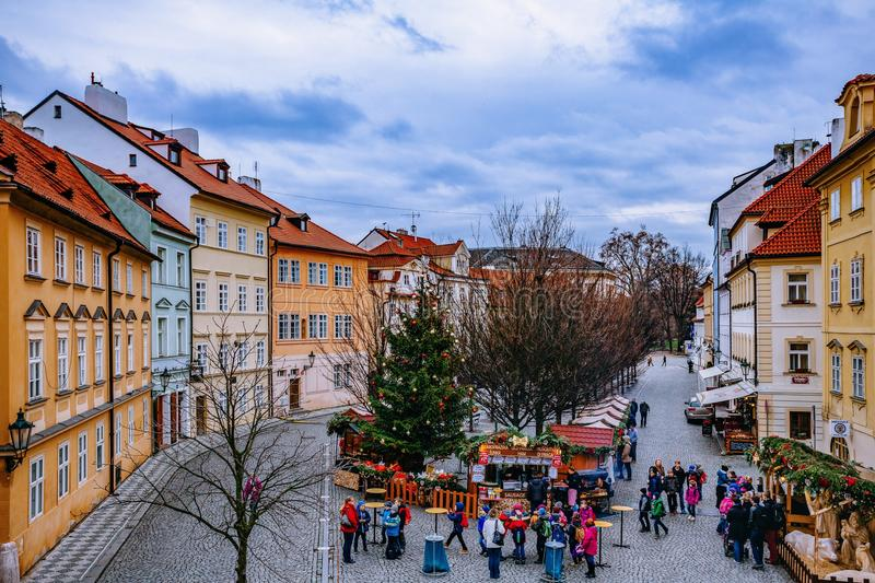 RAGUE, CZECH REPUBLIC - DECEMBER 22, 2015: Wooden stands offering souvenirs and traditional food during Christmas market royalty free stock photography