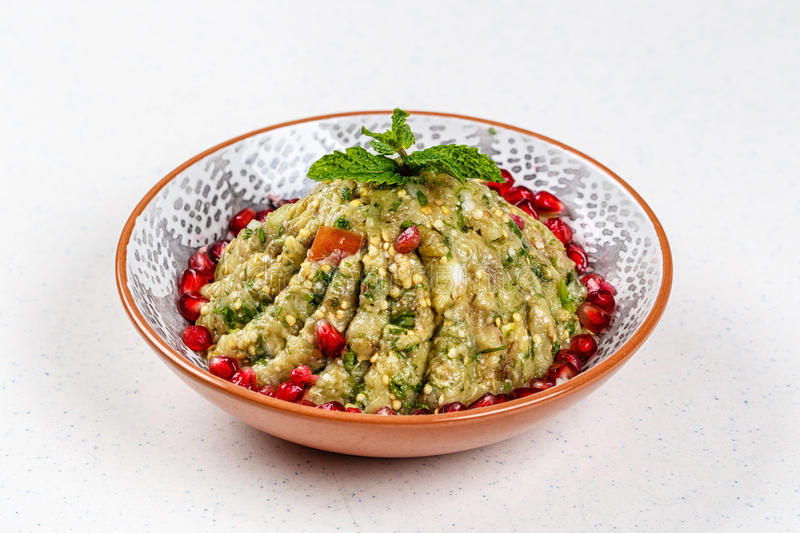 Raheb Salad served with pomegranate. Raheb Salad include Tomato, Bell Peppers, Parsley, Garlic, Onions, Freshly Squeezed Lemon Juice Virgin Olive Oil royalty free stock photography