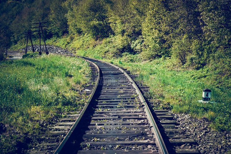 Rail goods path in the mountains. On a background of mountain slopes and forest, Carpathians, Ukraine royalty free stock images