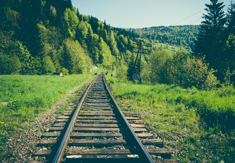 Rail goods path in the mountains. On a background of mountain slopes and forest. Carpathians, Ukraine stock images