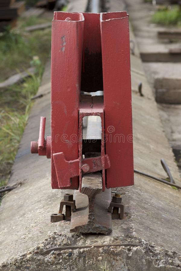 Rail limiter on the railway. Warehouse stock images