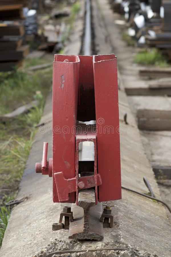 Rail limiter on the railway. Warehouse royalty free stock photos