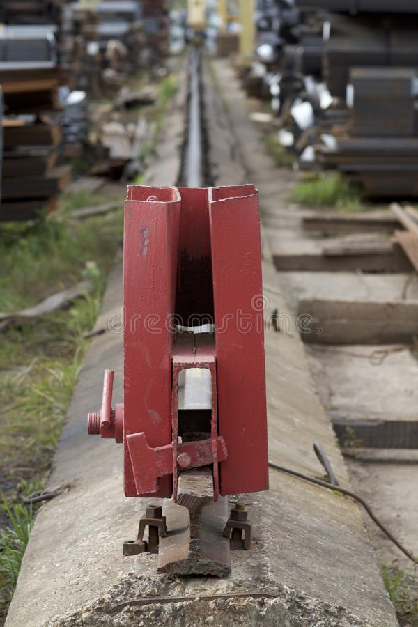 Rail limiter on the railway. Warehouse stock image