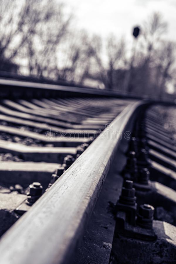 The rail of the railway goes into the distance. Toned, dark.  royalty free stock images