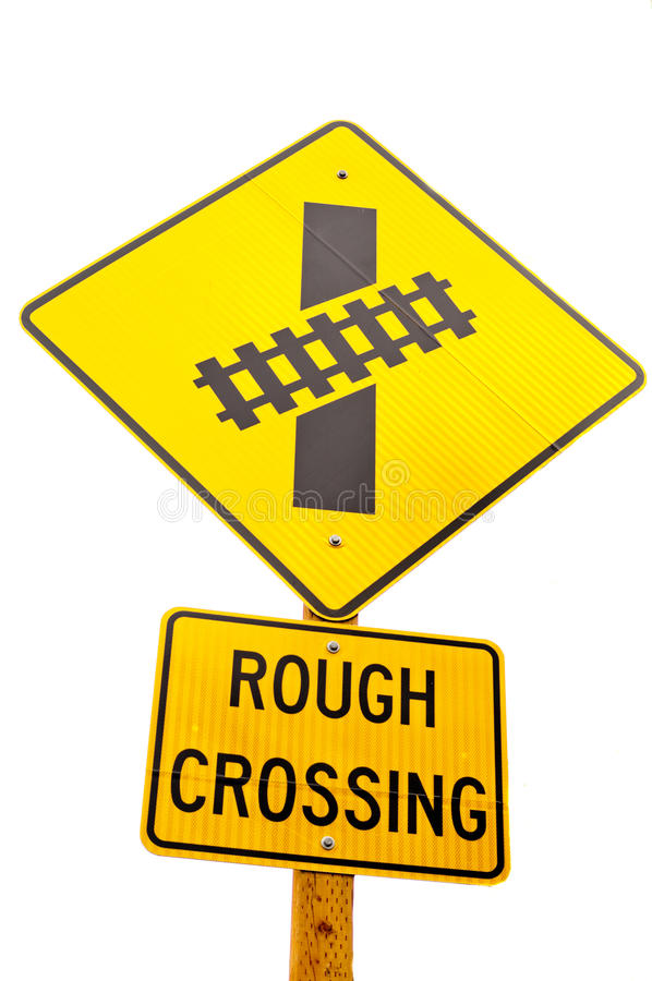 Rail Road Sign - Rough Crossing. Two yellow road signs posted one above the other on a wooden post. The top, diamond-shaped one shows a picture of railroad stock images