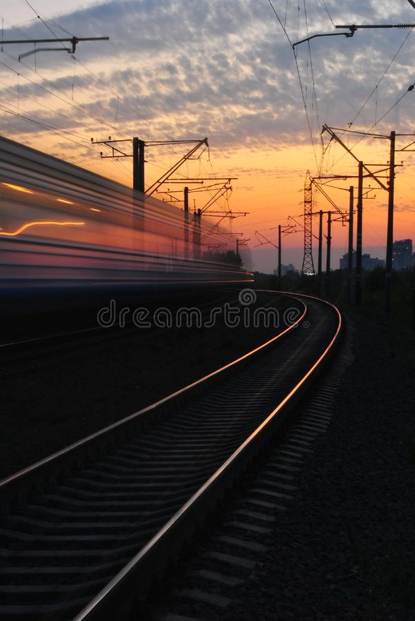 Rail Road Under Gray and Orange Cloudy Sky during Sunset royalty free stock photography