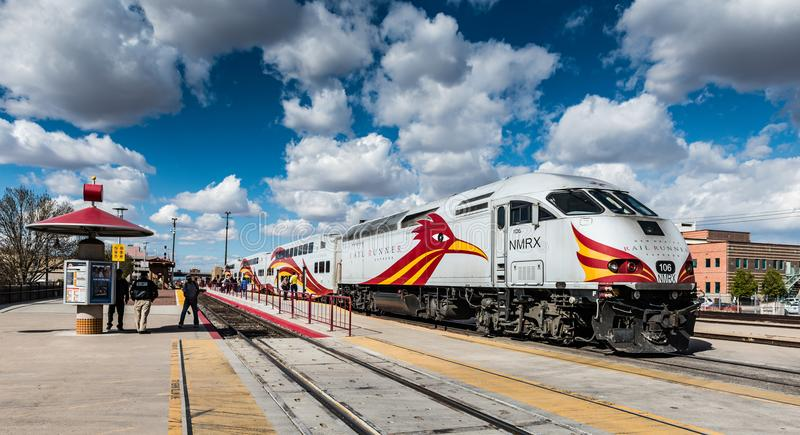 Rail Runner Express Boarding Passengers. Albuquerque, New Mexico / USA / April 1, 2016: Rail runner express, with colorful road runner painted on white train stock photography