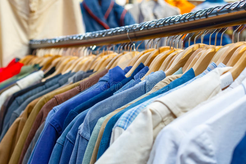 Rail of second-hand clothes on display. At Old Spitalfields Market in London stock image