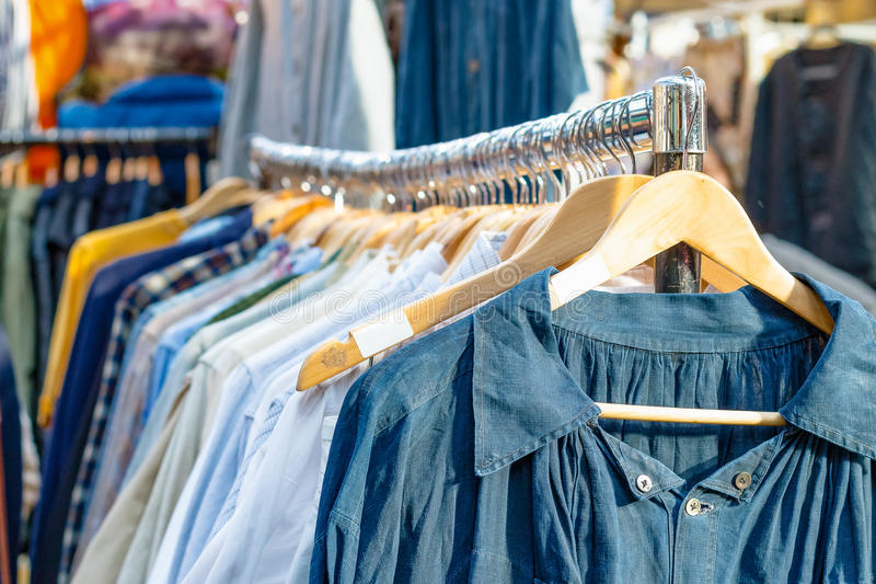 Rail of second-hand clothes on display. At Old Spitalfields Market in London stock photos