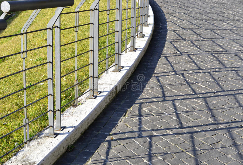 Rail and shade. Metal rail and shade, Italy stock photo