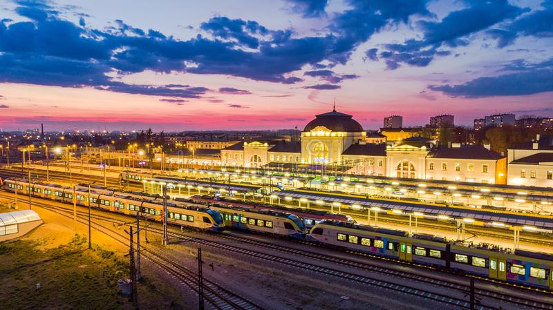 Rail station in Tarnow,Poland illuminated at twilight. Aerial blue building city life view cityscape colorful downtown drone dusk europe evening above historic stock photo