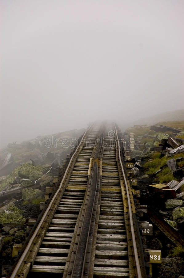 Rail to the fog. Railway and fog on the mount washington, new hampshire, usa royalty free stock photography