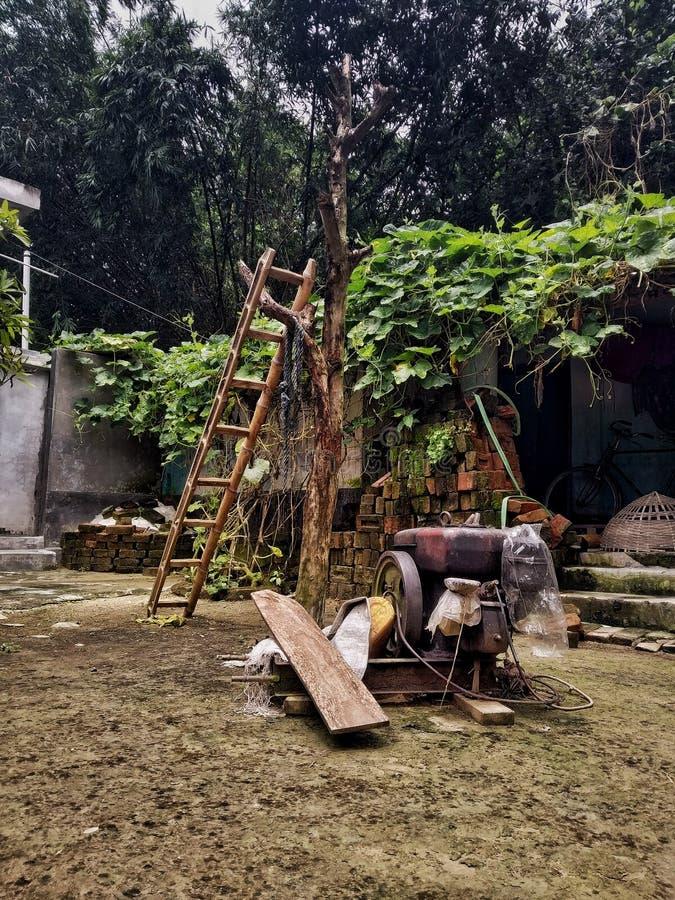Having fun with simple tools. Sky, clouds, symmetry, tracks, stones, bangladesh, uttara, dhala, dhaka, summer, winter, tools, motor, ladder, trees, lants stock photo