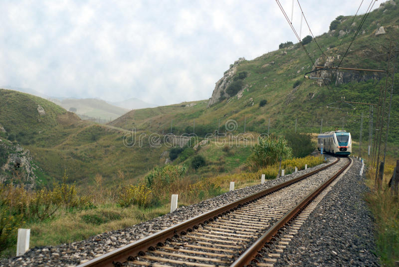 Rail train in countryside. Rail-train infrastructure in countryside, sicily - with train royalty free stock photography