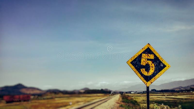 Rail train sign number five. Blur background royalty free stock photo