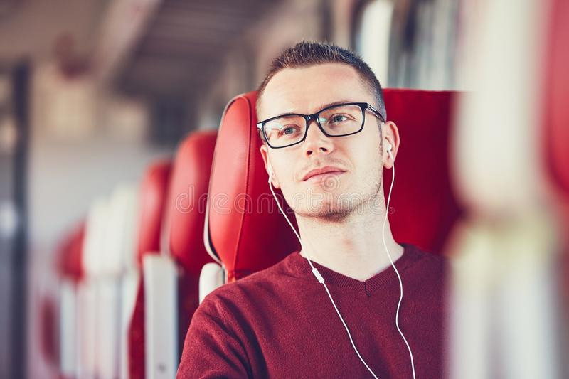 Young man traveling by train royalty free stock photos
