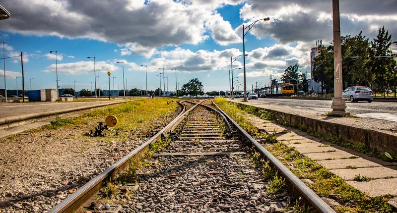 Rail way tracks with a beautiful scenic view in lisbon Portugal, date may 20 2019. Train track with  a beautifu  scenic view, aligned, blue, change, clouds royalty free stock photos