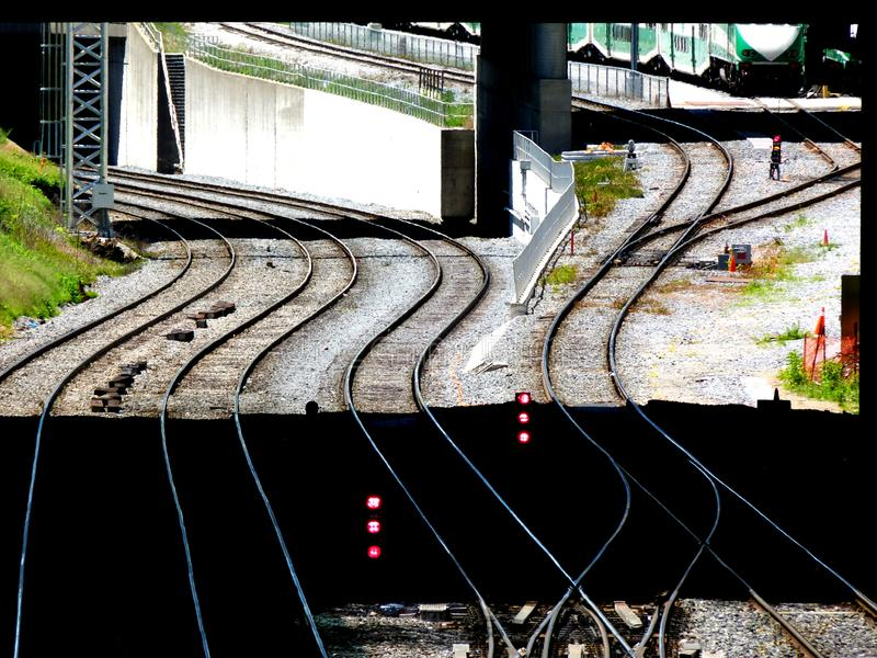 Rail yard with many train tracks and red signals royalty free stock photography
