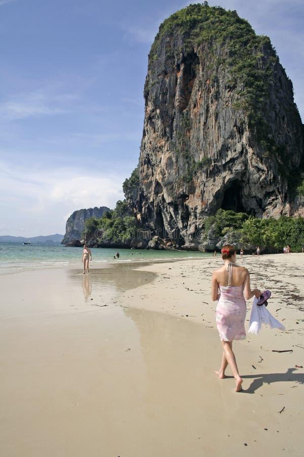 Railay Beach shore walk tourists thailand stock photo