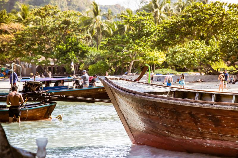 Railay, Krabi Province, Thailand - February 17, 2019: Long-tailed boats on the shores of a tropical island. Taxi boats are royalty free stock image