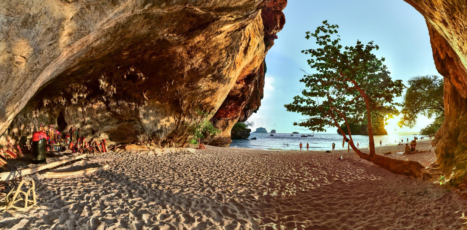Railay, Phra Nang beach and wooden phalluses in Princess cave. The large panorama, out on the road to Phra Nang beach and wooden phalluses in Princess cave in royalty free stock photo