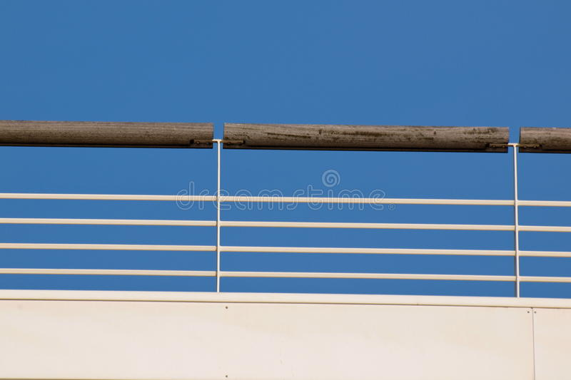 Download Railing Against A Blue Sky Royalty Free Stock Photography - Image: 18751217