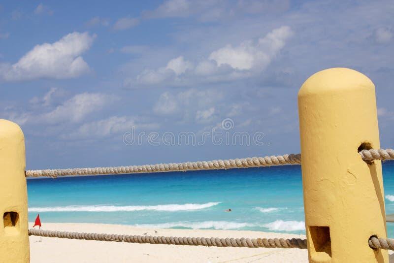 Railing along beach stock images
