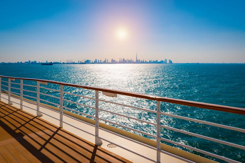 Railing of cruise ship with dubai skyline in the background. royalty free stock photo