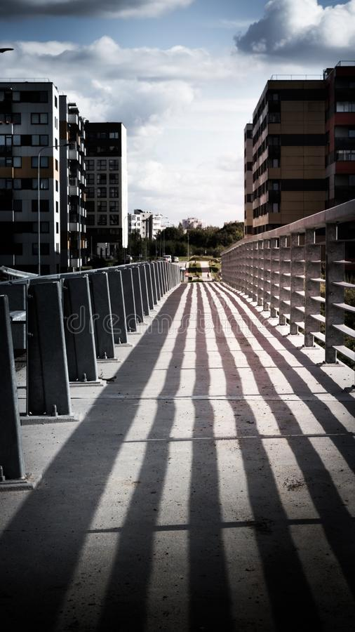 Railing shadow on a bridge stock photo