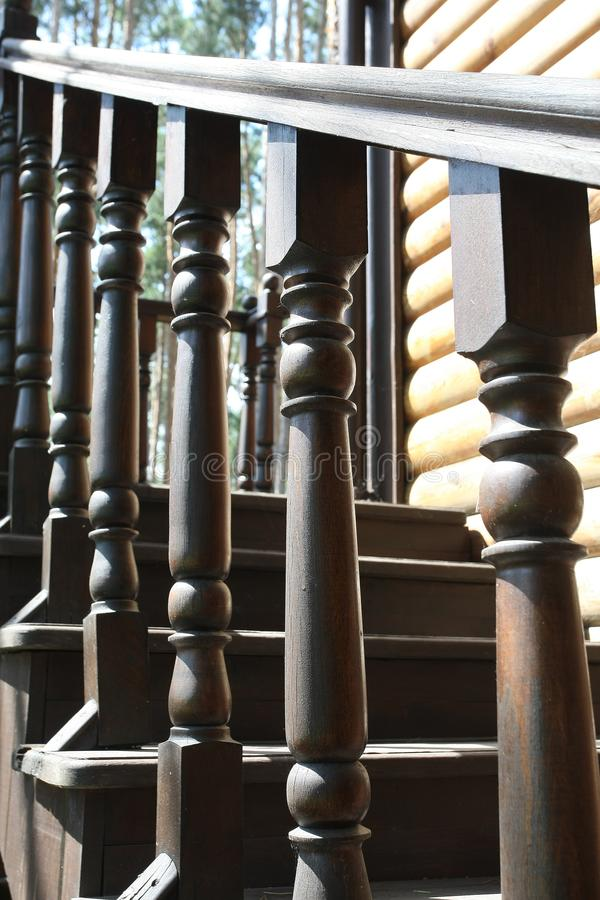 Railing of a wooden staircase stock image