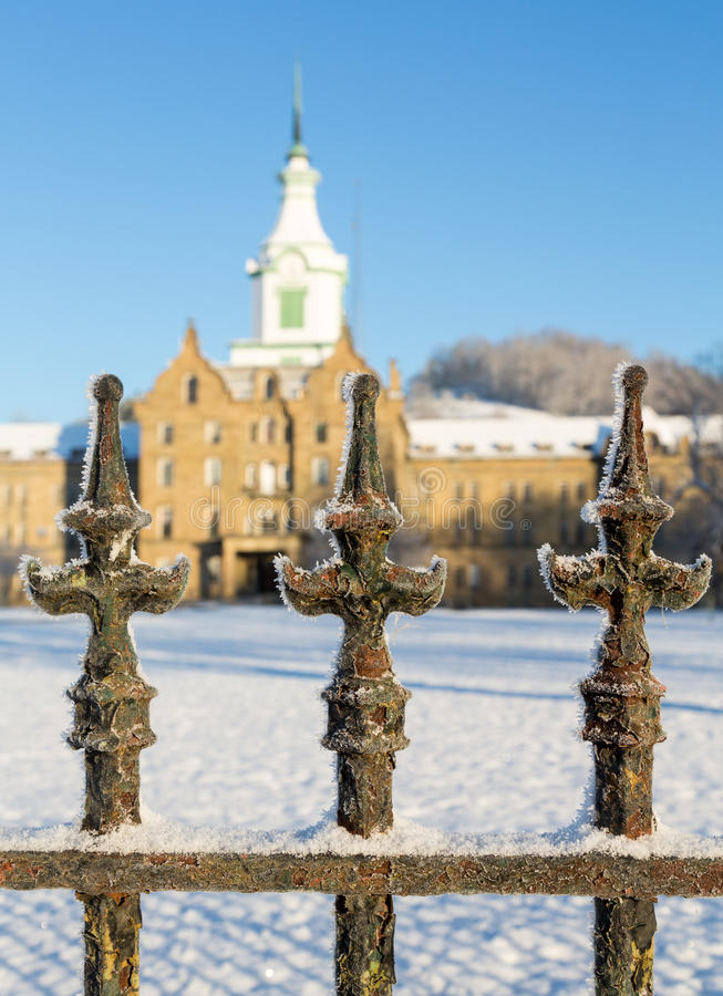 Railings in snow outside Trans-Allegheny Lunatic Asylum. Close up of cast iron railings outside Trans-Allegheny Lunatic Asylum in Weston, West Virginia, USA stock photography