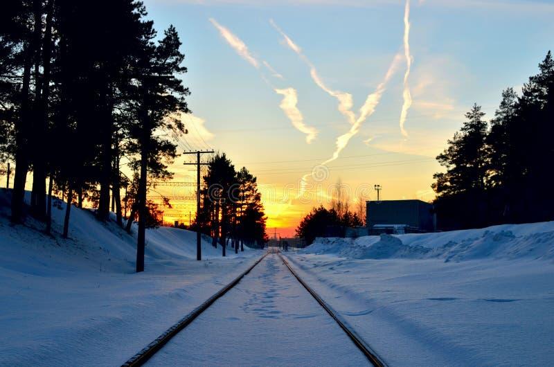 Railroad against beautiful burning sky at sunrise. royalty free stock photo