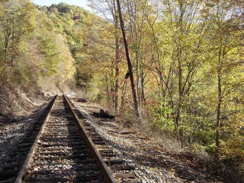Railroad in autumn. Norfolk-Southern railroad running through autumn colors along Winding Gulf Creek in Raleigh County, W.Va stock photos