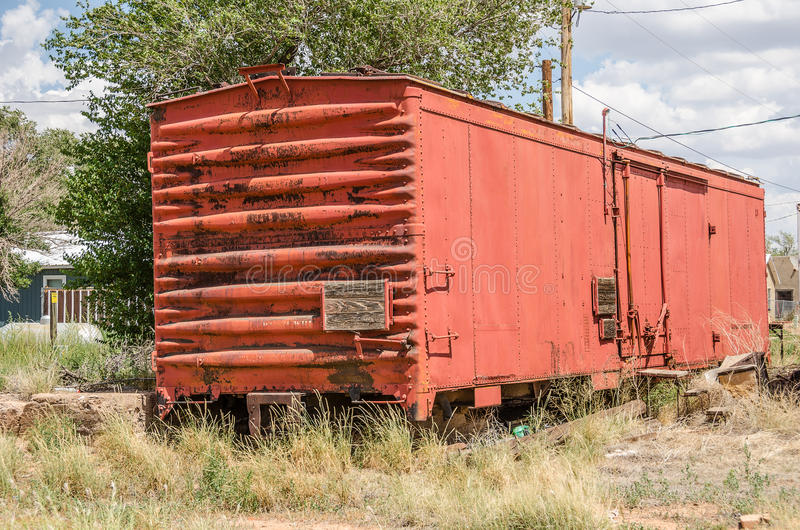 Railroad Boxcar. With a bit of rust parked behind some homes. Notice the three wood steps for help getting in royalty free stock image