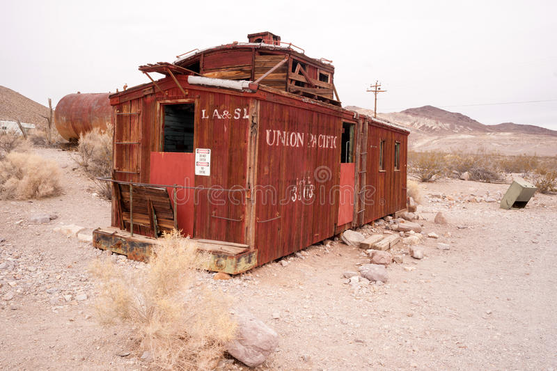 Railroad Caboose Rhyolite Ghost Town Nevada USA Death Valley. RHYOLITE, NEVADA/UNITED STATES - NOVEMBER 19: An old railroad caboose sits abandoned now a tourist stock photos