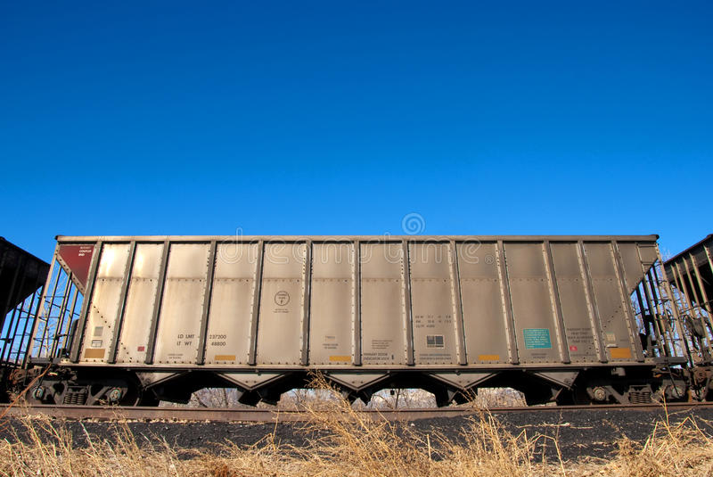 Railroad Car Under Bright Blue Sky royalty free stock image