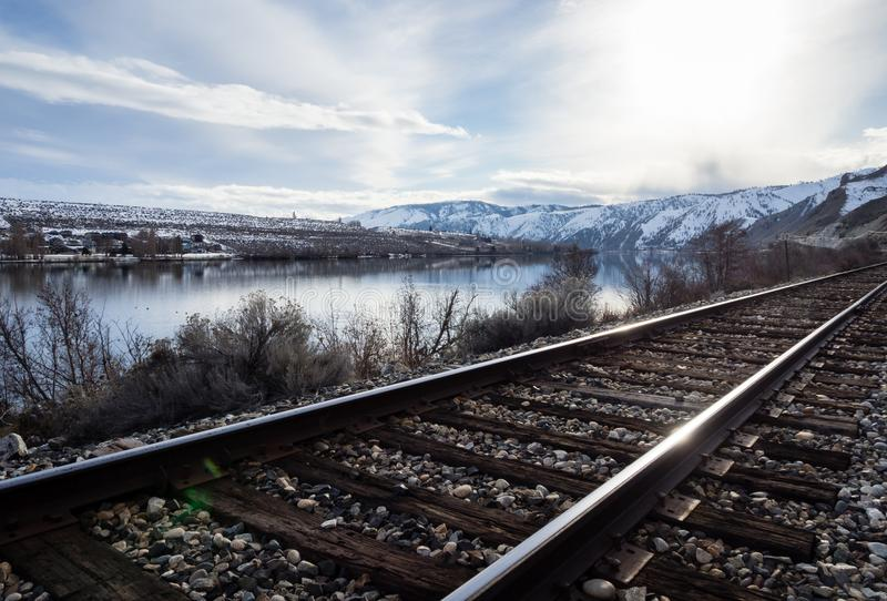 Railroad in Columbia river valley, WA. Railroad tracks running along the snow covered Columbia river valley north of Wenatchee, Eastern Washington state stock photography