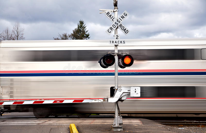 Railroad Crossing. With a train passing in hight speed royalty free stock images