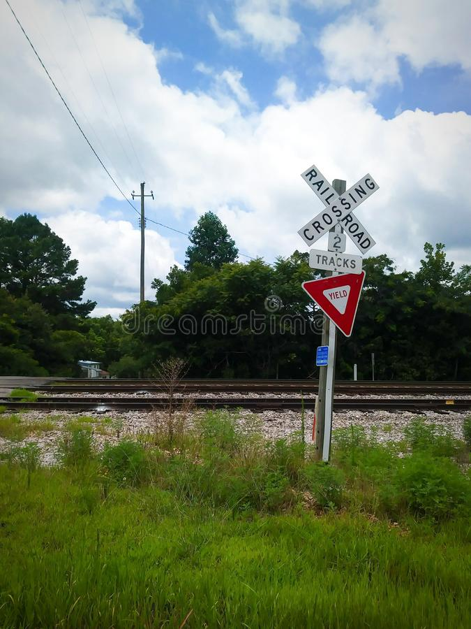 Railroad Crossing Road Sign. Street, traffic, drive, driving, safety, yield, signs, signage, symbol, symbols, warning, train, track, tracks, trains, railway royalty free stock photos