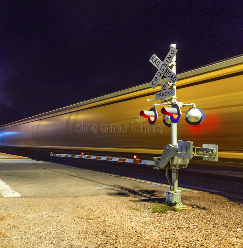 Free Railroad Crossing With Passing Train By Night Stock Images - 46572334