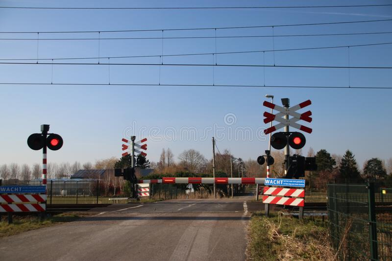 Railroad crossing in the Zuidplaspolder in Moordrecht the nether royalty free stock images