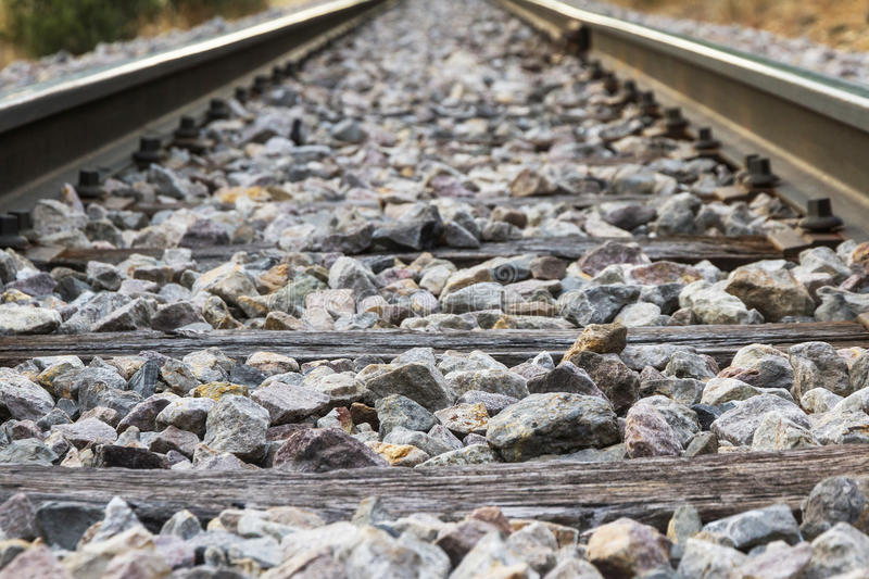 Railroad detail with Rails, Sleepers and Paving Stones stock images