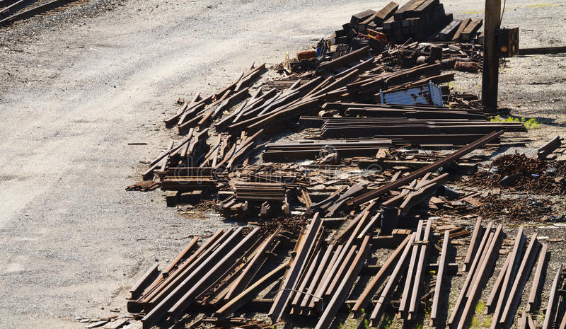 Railroad Industry Scrap Metal Piles. A pile of railroad industry rusty scrap metal on the edge of a railroad train yard in West Virginia. There are numerous royalty free stock photo