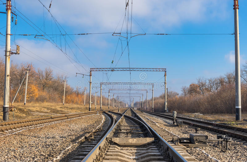 Railroad landscape at fall season royalty free stock images