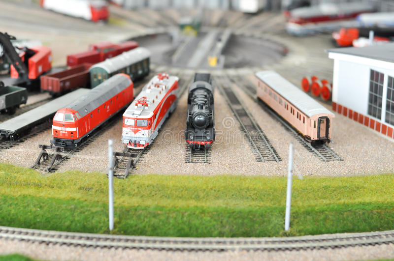 Railroad maquette with colorful trains royalty free stock photography
